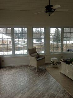 Sunroom on pinterest sunroom addition sun room and window for Sunroom tile floor ideas