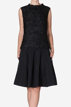 Raven Lace Ballerina Dress   Mixing delicate lace with structured taffeta creates a new dimension in this cocktail creation. The voluminous skirt is complimented by the lace is fitted through the body to elongate the silhouette. Finish this after hours look with black pumps for classic chic or have some fun with a pop colour