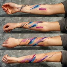 Abstract tattoo on the right forearm.