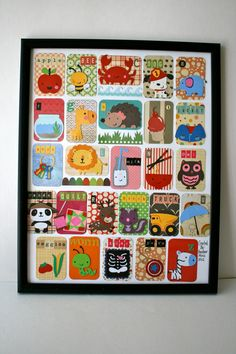 Alphabet cards put together as a set and attached to an artists quality piece of paper.. $50.00, via Etsy.