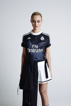 358d097d1e2b Real Madrid girl wearing the iconic black Real Madrid dragon jersey issued  in August 2014.