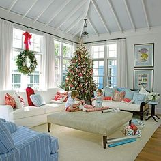 Merry Christmas!  A fun way to add some cheer to a beachy theme- love the subtlety with the red throw pillows, and of course, shells and starfish are a beach Christmas staple :)