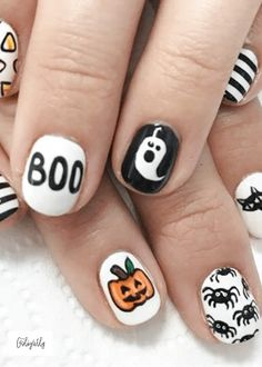 Halloween Nail Designs with Boom, Pumpkin Jackolantern, spiders, cats stripe and candy corn. During Halloween, it is fun to get dresses up in your favorite costume as well as match your Halloween Nail Design to your Halloween costume! #Halloween #NailDesigns #Pumpkin #AprilGolightly