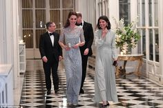 British Ambassador Edward Llewellyn (left) and his wife walk with  the Duke and Duchess of Cambridge before a diner at the British Embassy in Paris