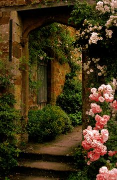 welcome friends and family with the warmth of stone framed with florals  www.concepts-in-design.com