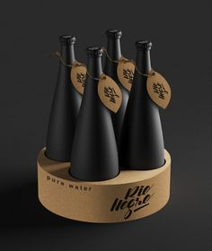 Incredibly matte bottles of water are coated in black and labeled with  cardboard.