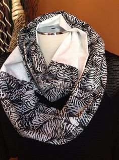 * Infinity Scarf, Two Colors    This striking black and white infinity scarf is ready to finish off any outfit with class. Dress this one up or