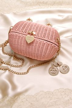 With enough room for the essentials, this pink Chanel heart closure basket bag would make the perfect Valentine's Day date bag. . . . #datenight #valentinesday #giftidea #giftsforher #chanel #chaneljewelry #chanelbag #pink #pinkbag #pinkpurse #crossbodybag #smallbag #heartbag #cc #cclogo #cclogojewelry #valentinesdaylook #datenightlook #outfitinspiration