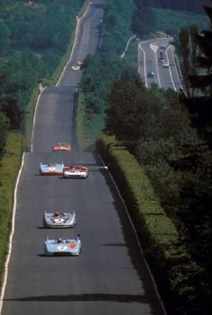 Nuerburgring, Doettinger Hoehe. In front two Porsche 908, the first should be Jo Siffert. In the back one Alfa 33/3 Yerar: 1971. More Info: http://www.racingsportscars.com/photo/Nurburgring-1971-05-30.html /Via Motorsportretro