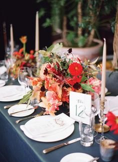 Saipuacreated these vibrant painterly centerpieces, which were set atop a deep-green silk tablecloth.