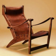 "Copenhagen lounge chair by Mogens Voltelen (1908-95), designed in 1936. Oak frame ""with saddle leather seat and back held on with straps and buckles. Crafted by Niels Vodder, Denmark."