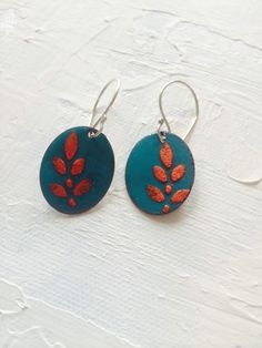 A personal favorite from my Etsy shop https://www.etsy.com/listing/251598435/turquiose-oval-earrings-with-orange