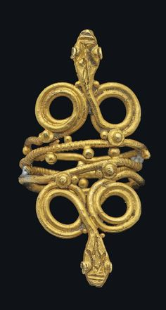 A ROMAN SNAKE RING  CIRCA 1ST CENTURY A.D.  Composed of a single strand of gold, coiled three times to form the hoop and twisted into a figure of eight at each end with snake head terminals, with added granular and incised decoration