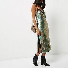 Sequin fabric with satin back Contrast neckline panel Cami straps Midi length
