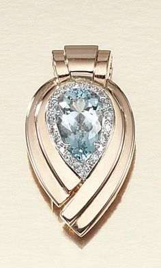 AQUAMARINE AND DIAMOND DRESS CLIP, CARTIER, 1940S.  Designed as a stylised pear-shaped scroll, centring on a similarly-shaped aquamarine within a border of single-cut diamonds, signed Cartier.