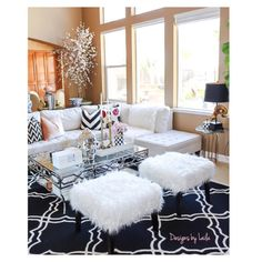 White fuzzy ottomans from @homegoods adds a perfect touch to my family room