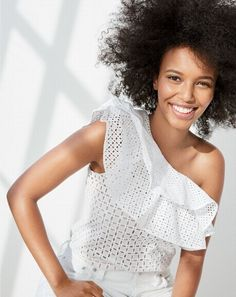 """""""I want lots of top options that aren't expensive, that I can wear with every pair of jeans in my closet."""" US: """"We got this."""" J.Crew women's one-shoulder ruffle top in eyelet."""