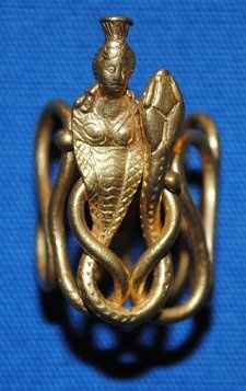 Gold finger-ring decorated with a bust of Isis and a snake's head. Roman,ca. 1st century.