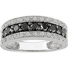 mens black diamond wedding ring its blingy but it will match the blinginess of the