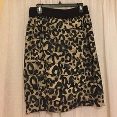 """Leopard Print Skirt Leopard print skirt, Alfani size 10. Zipper in back, cream and black colors. 16"""" across with stretchy band. 24"""" top to bottom. Alfani Skirts Midi"""