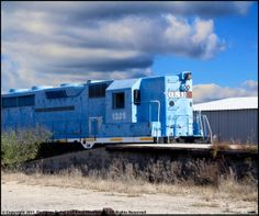 This Photoshop tutorial covers compositing an image that has a lot of similar colors in it, which makes it difficult to get clean selections with the magic wand tool. In this photograph, I want to change the sky to something less boring than the cloudless day, as you can see the train is also blue and the magic wand tool will inadvertently select portions of the train. This tutorial will show you how to use the quick mask tool to clean up the selection and drop a new sky into the image.