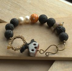 Ceramic house bracelet, Lava beads, lampwork bird, polka dot ceramic & Pearls £18.50