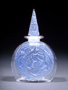 """R. LALIQUE Perfume bottle for Volnay, """"Mimeomai,"""" c. 1922, in clear and frosted glass with blue patina. Molded R. LALIQUE. M p. 950, No. 5. 4 3/4"""""""