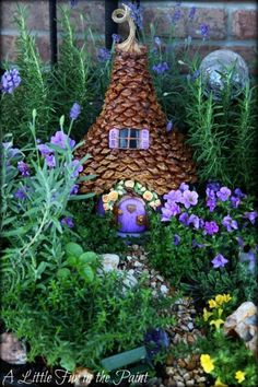 fairy house made with pine cone pieces and a pumpkin stem...and a purple door and window shades!
