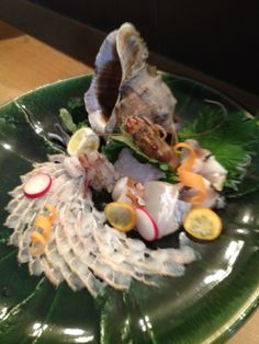 Anago (conger) Sashimi, Onomichi, HIROSHIMA.   Fresh local Anago is used for the dish at the restaurant, Kakehashi. (near the Hayashi Fumiko's statue)  Young and passionate owner chef and his wife work together there. Worth to stop and enjoy local flavors.
