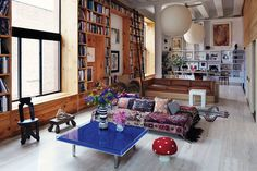 Love the bright colours against all the natural wood in this super cool NYC loft!