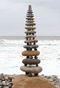 Pebbles working together to create a tower of powerful energy.  Like groups of people focused on the same intention is able to manifest that which they intend.