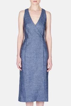 A cool blue blend of silk, linen, and wool imparts fluidity and texture to this wrap dress from the spring 2016 Protagonist collection. The sleeveless silhouette balances a deep v-neck with a racerback and a polished longer length. At the seamed and darted waistline, two concealed hook-and-eye closures—one on the right side and another on the left—ensure a smooth, flattering fit.