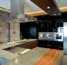 bachelor pad: Yaletown Loft Designed by Kelly Reynolds, Yaletown Loft Kitchen with High Quality Countertop and Exposed Brick Wall by Kelly Reynolds