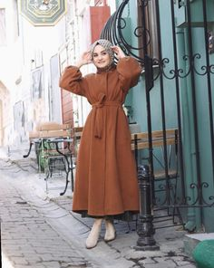 hijab dress The picture may contain: 1 person standing and Modern Hijab Fashion, Abaya Fashion, Muslim Fashion, Modest Fashion, Fashion Dresses, Hijab Style Dress, Casual Hijab Outfit, Hijab Chic, Dress Casual