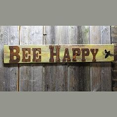 """Bee Happy Sign with busy Bee. Who doesn't want to BEE HAPPY? This cute sign has a springy bee shape flying around. Sign is Approximately 28"""" x 6"""" These are made to order. Your sign will NOT be the one in the images. ."""