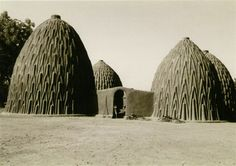 The Musgum houses in Cameroon are made from compressed sun-dried mud. Their dome shape are very close to the catenary arch, the ideal mathematical form for maximum rigidity with a minimum of material.   As well as being decorative, the raised pattern on the outside wall contribute to the drainage of rain and access to the top of the building for regular maintenance of the coating.