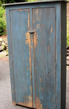 Distressed two-door reproduction primitive tall cupboard