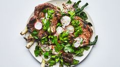 Pork chops with radishes and charred scallions - Pair rich, smoky charred meats with crisp, acidic vegetables and you'll never go wrong.
