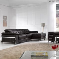 Africa sofa range encompasses modern style and design with this low and deep corner sofa. Featuring moveable hinged headrests, this corner sofa is made up of two sections which are clipped together. The headrests move independantly on each chair, providing comfort, support and versatility. Upholstered in soft, supple leather, the button back style of the seat and back cushions is accentuated with a chrome frame and feet, adding a contemporary twist to the Africa sofa range.