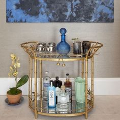 Even if you don't entertain often, think of it as an excuse to create an artful display of pretty bottles and glassware.