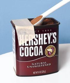 Attach the sticky side of a shorter piece of masking tape to the sticky side of a larger piece. Then place the tape across the top of a container of, say, cocoa so that the ends adhere to the sides of the can. The next time you scoop, you can easily level off your helping.