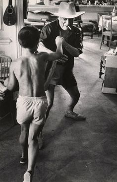 Picasso playfully spars with his son Claude at the Villa La Californie, 1957