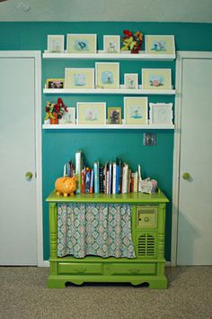 teal and lime green baby girl nursery bookcase and shelves. the book case is a DIY old TV cabinet that had the TV built in. they took it out, repainted and put a shelf inside to make it a nice heirloom piece for a kid room or play room!