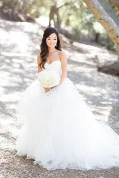 Gorgeous flowing wedding dress: http://www.stylemepretty.com/little-black-book-blog/2014/09/19/shabby-chic-calamigos-ranch-wedding/ | Photography: Koman Photography - http://komanphotography.com/