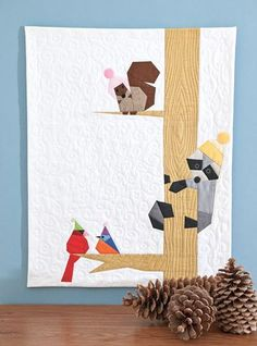 Winter Critters Quilt Kit: Backyard buddies bundle up for the winter in this foundation-pieced wall quilt designed by Sonja Callaghan.