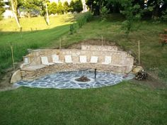 Building a DIY stone wall and bench into hill with fire pit