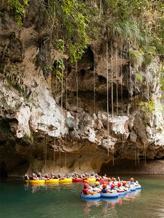 Head for adventure in Belize! Go cave tubing at Jaguar Paw in Belmopan. Float down the river on an inner tube with only a headlamp to light your way. This journey through an underground cave system requires visitors to maneuver around stalagmites jutting from the river and stalactites looming from above.