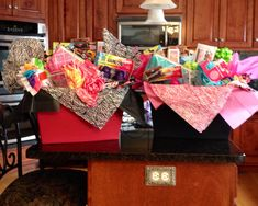 Gift Baskets for the pre-teen girls (good time for their own flat iron, hair dryer, curling iron, perfume, lotions, candy, gift cards, Justice clothes, water bottle, books, socks, cute flip flops, picture frames, etc)