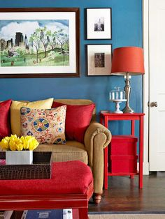 A palette of blue, red, and yellow make for a dramatic and lively living area!  via bhg.com
