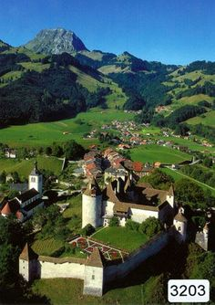 Switzerland Travel Inspiration - Gruyères Suisse - Fantastic photo of the village